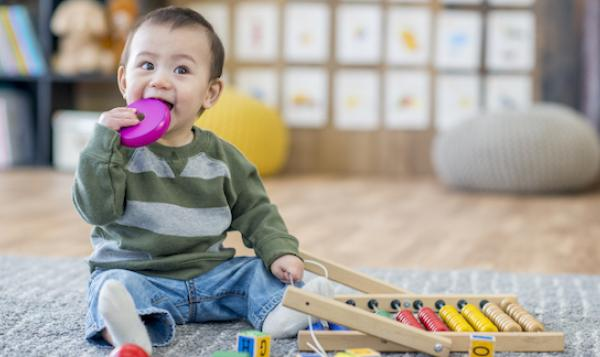 Infant boy with blocks playing.